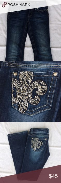 Miss Me Boot Cut Sz 29 Miss Me Boot Cut Sz 29. Condition: Pre-owned, good condition. Back pockets are embellished with fleur de lis & bling. Silver stitching throughout, zip front with single button, dark wash (DK 98), distressed (including bottom cuffs). Style #: JP5375B. 98% Cotton, 2% Elastic. Miss Me Jeans Boot Cut