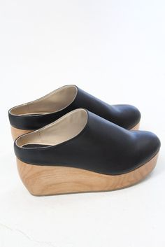 "Natural wood wedge base, black faux leather. Runs true to size. Whole sizes only. 3"" back with a 1.5"" platform. Handmade by artisans in Los Angeles atelier, consciously constructed shoes are free of a"