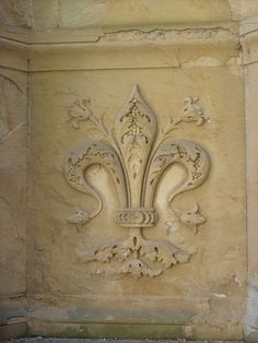 Fleur de lis ....would be pretty as decorative inset over gas cooktop.