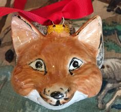 A personal favorite from my Etsy shop https://www.etsy.com/listing/561166760/hand-painted-bisque-fox-christmas