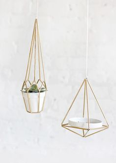 These DIY geometric brass hangers can hold jewelry dishes, plants, and can even be used as light fixtures.