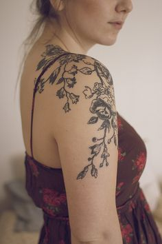 Beautiful floral work. Continue the pattern for chest/breast coverage. Nice idea for mastectomy tattoo. [p-ink.org]