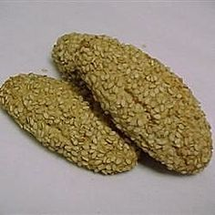 These are Italian-style biscuits rolled in sesame seeds. You can a few drops of anise oil too for a sweet flavour. Italian Sesame Seed Cookies, Recipe For Sesame Cookies, Italian Cookies, Italian Biscuits, Wine Cookies, Bar Cookies, Anise Oil, Italian Wedding Cookies, Flavored Butter