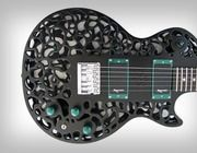 """Olaf Diegel, a professor of mechatronics at Massey University's School of Engineering & Advanced Technology in New Zealand, developed a series of stunning 3D-printed guitars that are completely playable. The """"Atom"""" guitar and other available models are beautifully intricate."""