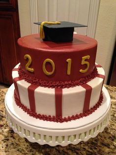 Maroon, white, and gold graduation cake with buttercream icing and fondant details.  https://www.facebook.com/sweetnsassycakesbyeva