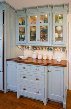What I like - Glass doors, glass shelves, lights in cabinet. Would be great around sink for Fiesta dinnerware collection