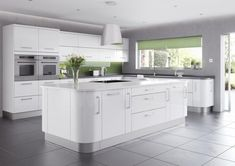 White gloss kitchen in a modern & uncluttered slab style.