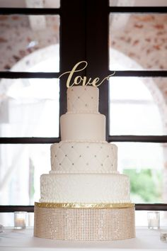 Glamorous cake, rhinestones, cushion-cut fondant, four tiers, gold love topper // Nelson Photography