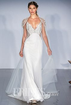 Brides.com: . Trend: Cutouts. Sleeveless embroidered tulle A-line wedding dress with a beaded v-neck bodice and cutout details, Alvina Valenta