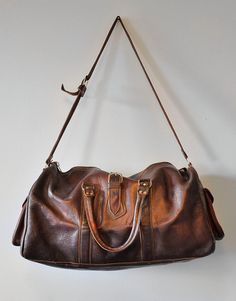Vintage Brown Leather Duffle Bag by BombyxMoriVintage on Etsy, $89.00