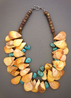 Necklace | Anna Holland.  Teardrop shaped shells, combined with turquoise.  Sold