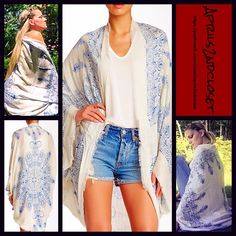 """Boho Kimono Wrap Cardigan Oversized Boyfriend NEW WITH TAGS RETAIL PRICE: $68  Boho Kimono Cape Wrap Cocoon Blanket Cardigan  * Relaxed & Oversized Wrap Silhouette  * Beautiful henna print & frayed fringe   * Incredibly lightweight for most seasons  * Cocoon like style with long wide kimono sleeves (cardigan style)  * Oversized fit; About 41.5"""" long in the back  Fabric: 100% Viscose Item: Color: Blue & Ivory Combo   No Trades ✅Offers Considered*/Bundle Discounts✅ *Please use the blue 'offer'…"""