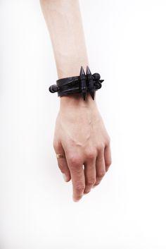 PETTERI HEMMILA, AHTI CUFF: black leather with spikes.