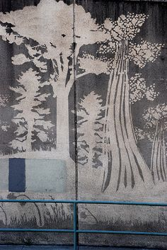 reverse graffiti- taking away the years of  pollution, grime, and decay to reveal a beautiful work of art.