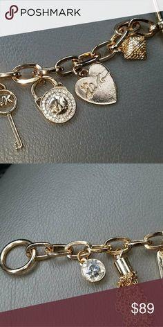 Michael kors AUTHENTIC charm bracelet Gold tone charm bracelet BEAUTIFUL Michael Kors Jewelry Bracelets