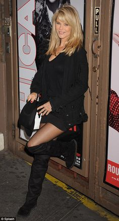 We'll have what she's having: A very youthful Christie Brinkley appears to defy age as she posed outside a New York theatre flashing her trim figure and sexy legs