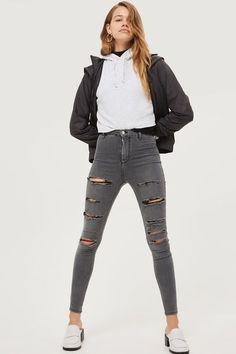These MOTO high rise, super skinny jeans in grey super stretch denim can be pulled on to complete any look. The rip detail, ankle grazing cut means that your shoes can make the statement. We've styled them with a cropped hooded sweatshirt and on-trend slip on shoes for a casual look that works for day or night.