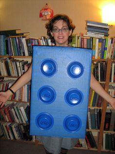 A Lego brick costume requires only a box, some plastic bowls, and some paint.