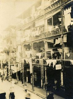 Chinese Tenements with Laundry Hong Kong c.1930s  there were a lot of tenements in 1965 when were there; lines would be strung from one building to the next, with laundry hanging to dry......  There were the very wealthy; there were the very poor.