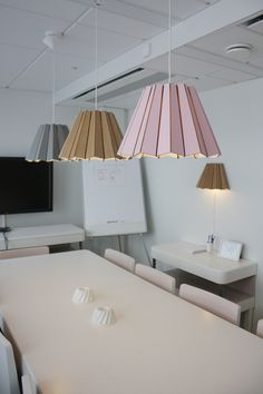 Corrugated cardboard pendant light from Finnish lighting company Andbros. The eco-friendly lights can be shipped in a flat pack. Made in Finland. The lights are seen here in the conference room at Bob the Robot