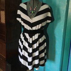 Striped V-Neck Dress Worn once. There are no stains on this dress. Tag is labeled large but it fits a extra large to a 1X. This accessories in this listing (belt & necklace) are not included nor are they for sale. All of my items come from a teacup Chihuahua smoke-free & odor-free home. If you have any questions, do not hesitate to ask I am online daily. Dresses