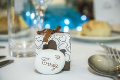 A lovely brown and white favour love heart box with a stone engraved name tag.