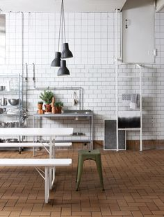 easy to do, industrial style kitchen; white subway and 4x4 or 6x6 similar color wall tile, chrome open utility elements, and quarry tile flooring  photo via Susanna Vento
