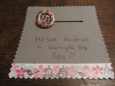 #Hairslides #Handmade in #Harrogate by Poppy. Black and pink floral print wooden button. My range of handmade hairslides are available at Hush Jewellery shop in the Victoria Shopping Centre in Harrogate, North Yorkshire. Come in and see us, we have a fantastic range of jewellery, scarves and accesories. Or have a look at the shop on their Twitter, @HushJewellery, and my hairslides on Twitter @Poppys_Buttons. Thank you!