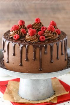 This Raspberry Chocolate Layer Cake is super moist and layered with smooth chocolate ganache and raspberry filling, all covered in a fudgy chocolate frosting! It's rich, full of chocolate and…MoreMoreThis Moist Chocolate Cake recipe is seriouslyA Heavenly Chocolate Cake Recipe, Chocolate Drip Cake, Chocolate Raspberry Cake, Chocolate Frosting, Chocolate Cupcakes, Choco Chocolate, Chocolate Cheesecake, Chocolate Desserts, Chocolate Birthday Cakes