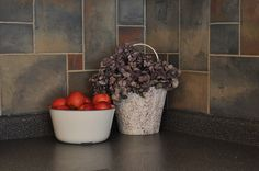 How to faux slate backsplash...drywall compound and recycled paint.
