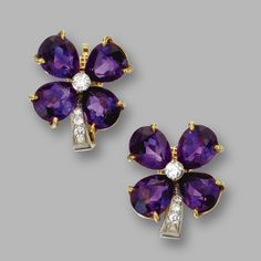 PAIR OF AMETHYST AND DIAMOND FLOWER EARCLIPS, TIFFANY & CO. Round diamonds weighing approximately .40 carat, mounted in 18 karat gold and platinum, signed Tiffany & Co.