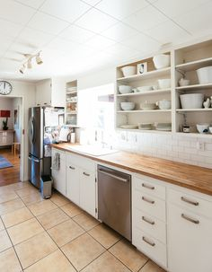 Open shelving makes the kitchen feel more airy.