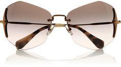 43558a179118 Miu Miu Hexagonal-frame sunglasses The Pink Frock