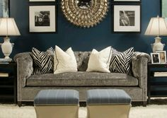 Dark blue walls, black & white accents w/ a grey couch...modern