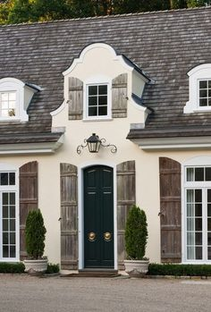idea on how they used natural wood shutters. Door painted a different color from the windows...