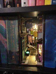 Book Nook Shelf Inserts Make Your Bookshelf Even More Magical Book Nook Bookshelf Insert Dioramas Deco Harry Potter, Theme Harry Potter, Harry Potter Room, Harry Potter Clock, Harry Potter Diagon Alley, Slytherin, Hogwarts, Harry Potter Weihnachten, Vitrine Miniature