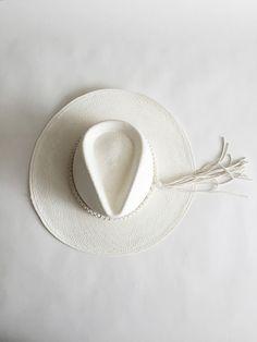 Straw panama hat by Ryan Roche. Wide round brim. Color- White