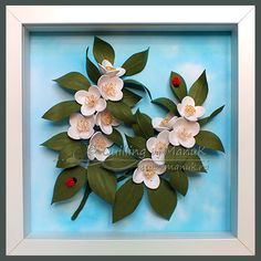 Quilled jasmine flowers made with 1mm wide paper strips and framed in a shadowbox frame.