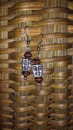 Faceless - Wooden - The profit from the sale of these earrings helps to rescue a victim of human trafficking AND money is contributed to eradicate poverty!