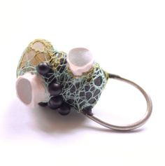 Ring | Ela Bauer. Epoxy, pebbles, yarn, onyx, silicone, silver- exciting mixed media piece, reminds me of bacteria.