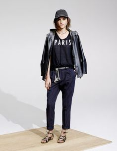 STYLING LESSON: When in doubt, add a baseball cap and wear your jacket as a cape.