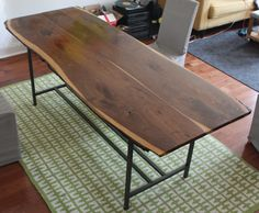 Live edge walnut and raw steel table…