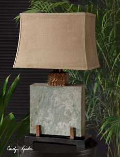 Outdoor lamp from Uttermost is made of hand carved slate with hammered copper accents and features an outdoor fabric shade.  Heavy and impressive.