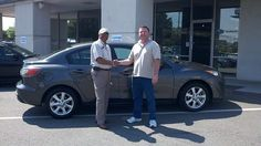 Folger Subaru Internet Sales Consultant Bill Barber with Mr. Stanley and his 2011 Mazda3 sedan!