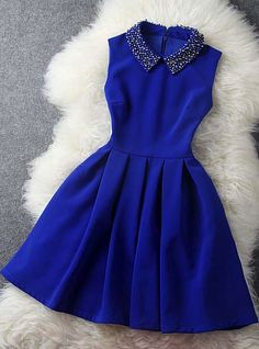 Blue dress with beaded collar                                                                                                                                                                                 More