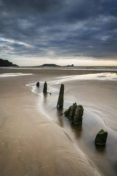 Not sure WHY you wouldn't believe there in Wales, but they sure are handsome. Here: Rhosilli Bay, Swansea, Wales Great Places, Places To See, Honeymoon Photography, Visit Wales, All Nature, British Isles, Beautiful Beaches, Places To Travel, Travel Destinations