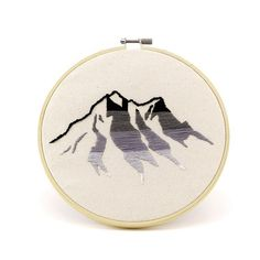 Greyscale mountain embroidery