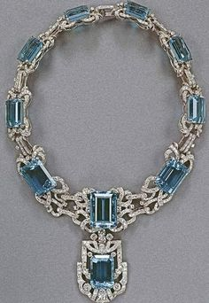 An aquamarine and diamond necklace, which is part of a parure including a tiara and brooch. This necklace belongs to Queen Elizabeth II, and is worn often by her