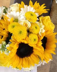 Wedding Bouquet with Yellow Sunflowers, Yellow Button Poms, White Stock, Yellow and White Roses  www.darlingflowers.net