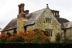 """Old English stone home: One of Rupyard Kipling's homes in England. He wrote of gardening that """"the glory of the Garden occupieth all who come"""". [Like the English charm, aged feel, overall shape/design, stone pattern, and chimney pots] Unique Cottages, Stone Interior, Home Garden Design, Unusual Homes, English House, European House, Old Stone, Stone Houses, English Countryside"""